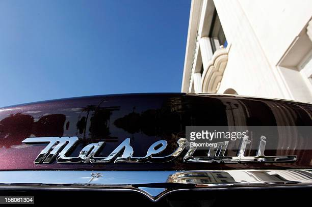 A logo sits on the trunk of a new Quattroporte V8 automobile produced by Maserati the luxuryauto maker owned by Fiat SpA during its debut in Nice...