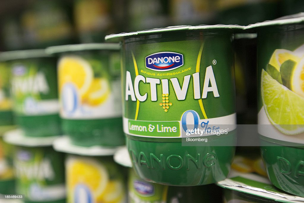 A logo sits on the tub of a 0% fat Activia yoghurt, produced by Danone SA, inside an Asda supermarket, the U.K. retail arm of Wal-Mart Stores Inc., in Watford, U.K., on Thursday, Oct. 17, 2013. U.K. retail sales rose more than economists forecast in September as an increase in furniture demand led a rebound from a slump the previous month. Photographer: Simon Dawson/Bloomberg via Getty Images