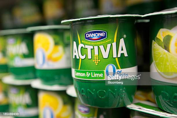 A logo sits on the tub of a 0% fat Activia yoghurt produced by Danone SA inside an Asda supermarket the UK retail arm of WalMart Stores Inc in...