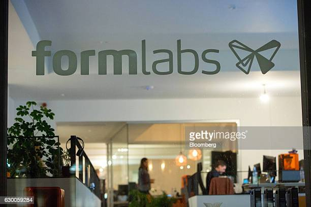 A logo sits on the window at the offices of 3D printing and design company Formlabs GmbH in Berlin Germany on Tuesday Nov 8 2016 The 3D printing...