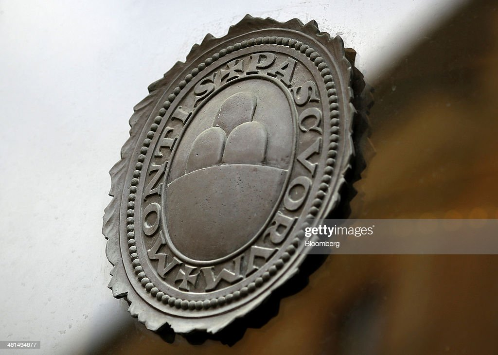 A Logo Sits On The Window Of A Banca Monte Dei Paschi Di Siena Spa