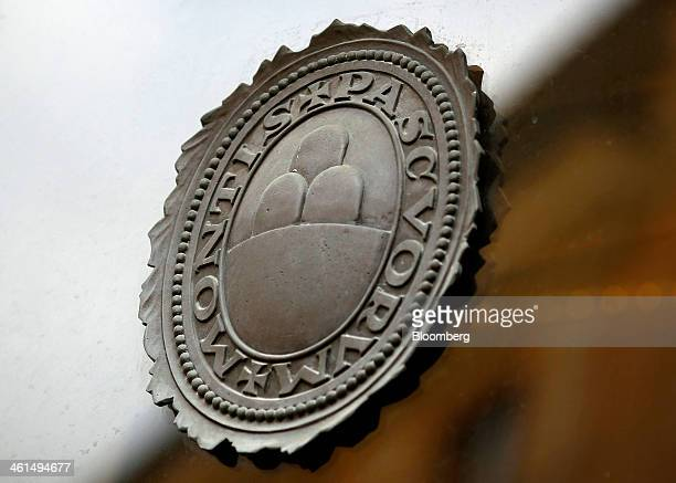 A logo sits on the window of a Banca Monte dei Paschi di Siena SpA bank branch in Siena Italy on Wednesday Jan 8 2014 Monte Paschi the bailed out...