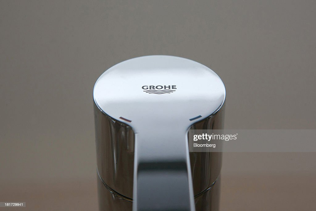 A logo sits on top of a bathroom tap, manufactured by Grohe Group, inside a bathroom store in Berlin, Germany, on Tuesday, Sept. 24, 2013. Lixil Corp., a Japanese toilet maker, is in advanced talks to buy German bathroom-fixtures company Grohe Group for more than 3 billion euros ($4 billion), according to people with knowledge of the matter. Photographer: Krisztian Bocsi/Bloomberg via Getty Images