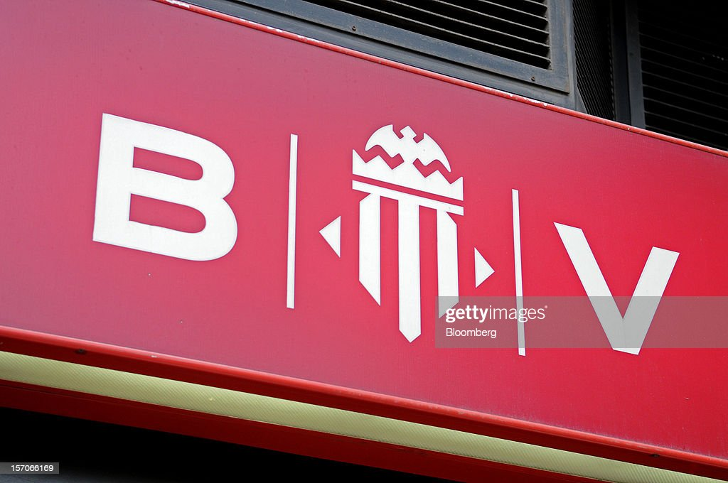 A logo sits outside a Banco de Valencia SA bank branch in Barcelona, Spain, on Wednesday, Nov. 28, 2012. Spanish banks getting European aid will shrink their balance sheets more than 60 percent, the European Commission said, as BFA-Bankia, the biggest rescued lender, expects to lose 19 billion euros ($25 billion) this year. Photographer: Stefano Buonamici/Bloomberg via Getty Images