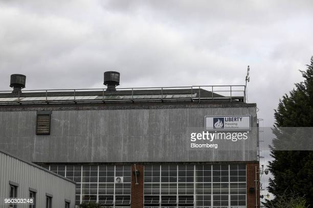 A logo sits outside the Liberty Pressing Solutions facility in Coventry UK on Monday April 23 2018 Aluminum markets are still reeling from US...