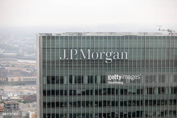 Logo sits outside the offices of JPMorgan Chase & Co. In the Canary Wharf business and shopping district in London, U.K., on Wednesday, May 17, 2017....