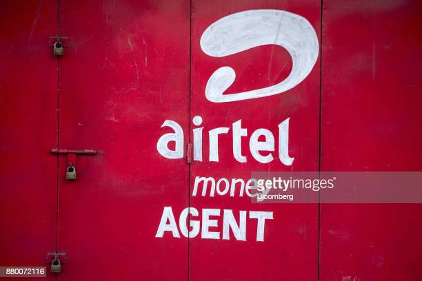 A logo sits painted on the exterior of a Bharti Airtel Ltd money agent shop in Mombasa Kenya on Thursday Nov 23 2017 The countrys Treasury has...