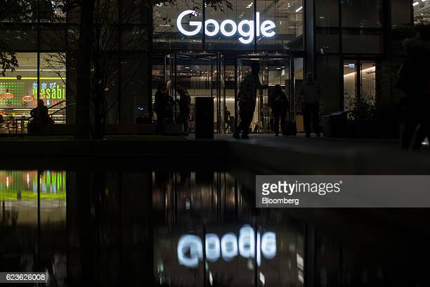 Logo stands above the entrance to Google Inc.'s Kings Cross office in London, U.K., on Tuesday, Nov. 15, 2016. After being criticized for not paying...