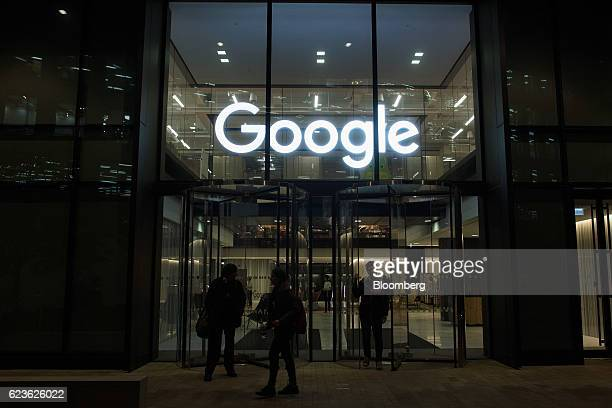 A logo stands above the entrance to Google Inc's Kings Cross office in London UK on Tuesday Nov 15 2016 After being criticized for not paying its...