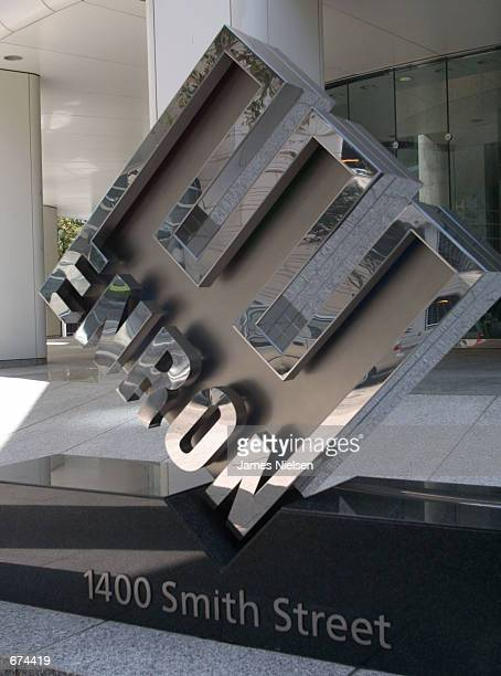 A logo stands in front of the new corporate headquarters of the Houstonbased energy trading firm Enron November 29 2001 in Houston Texas The energy...
