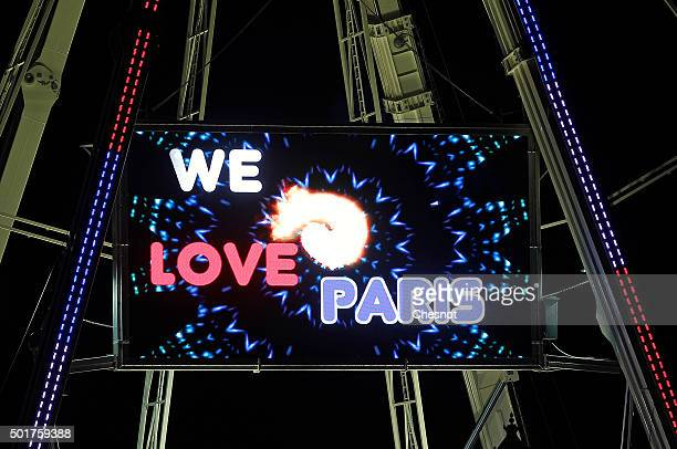 A logo 'We love Paris' is displayed on the Ferris wheel at 'Place de la Concorde' during Christmas illuminations on December 17 2015 in Paris France...