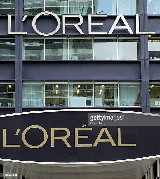 Logos above the main entrance of the L'Oreal SA headquarters in Clichy near Paris France Wednesday February 18 2004 L'Oreal SA the world's largest...