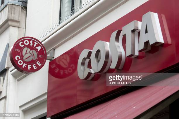Logos are pictured above a Costa coffee shop in London on November 15 2017 / AFP PHOTO / Justin TALLIS