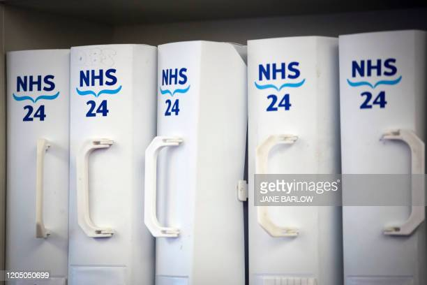 NHS logos are pictured on box files at the NHS 24 contact centre at the Golden Jubilee National Hospital in Glasgow Scotland on March 4 2020 Up to...