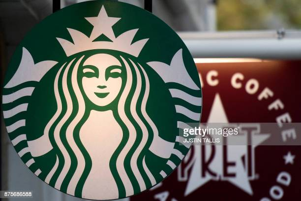 Logos are pictured on signs outside Starbucks and Pret a Manger coffee shops in London on November 15 2017 / AFP PHOTO / Justin TALLIS