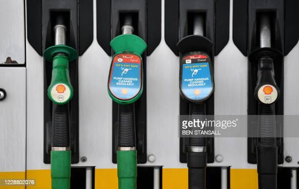 Logos are pictured on unleaded and diesel fuel pumps at a Shell petrol station in Etlham, southeast London on September 30, 2020. - Royal Dutch Shell...
