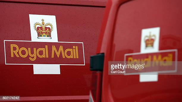Logos are pictured on vans at Royal Mail's Mount Pleasant Mail Centre on December 21 2015 in London England This week is expected to be the busiest...