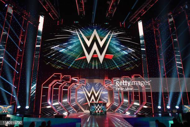 WWE logos are shown on screens before a WWE news conference at TMobile Arena on October 11 2019 in Las Vegas Nevada It was announced that WWE...