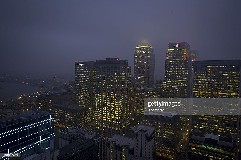 Logos for Citigroup Inc., right, and JPMorgan Chase & Co., left, are seen illuminated at night on office buildings in the Canary Wharf business and financial district in London, U.K., on Monday, Feb. 11, 2013. U.K. inflation held at the highest rate since May last month and pipeline prices pressures increased as crude oil costs rose. Photographer: Jason Alden/Bloomberg via Getty Images