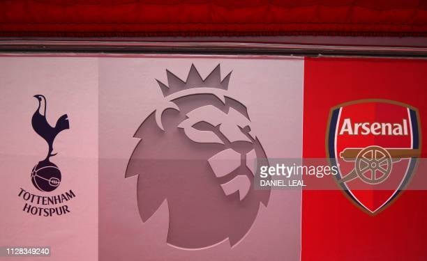 Logos for the English Premier League and both teams are pictured inside the stadium ahead of the English Premier League football match between...