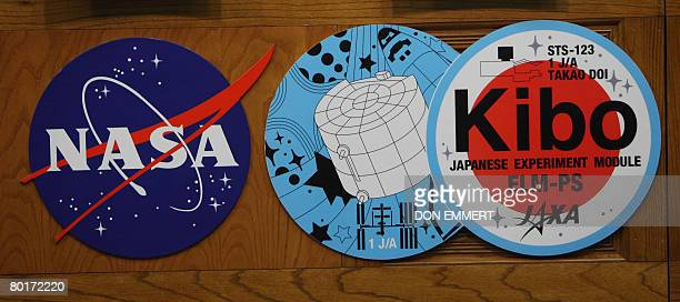 Logos for the Japanese experiment logistics module Kibo and NASA are seen at a briefing on March 8 2008 at the Kennedy Space Center in Florida The...
