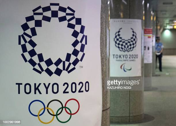 Logos for the upcoming Tokyo 2020 Olympic Games are displayed at a subway station in Tokyo on July 21 2018