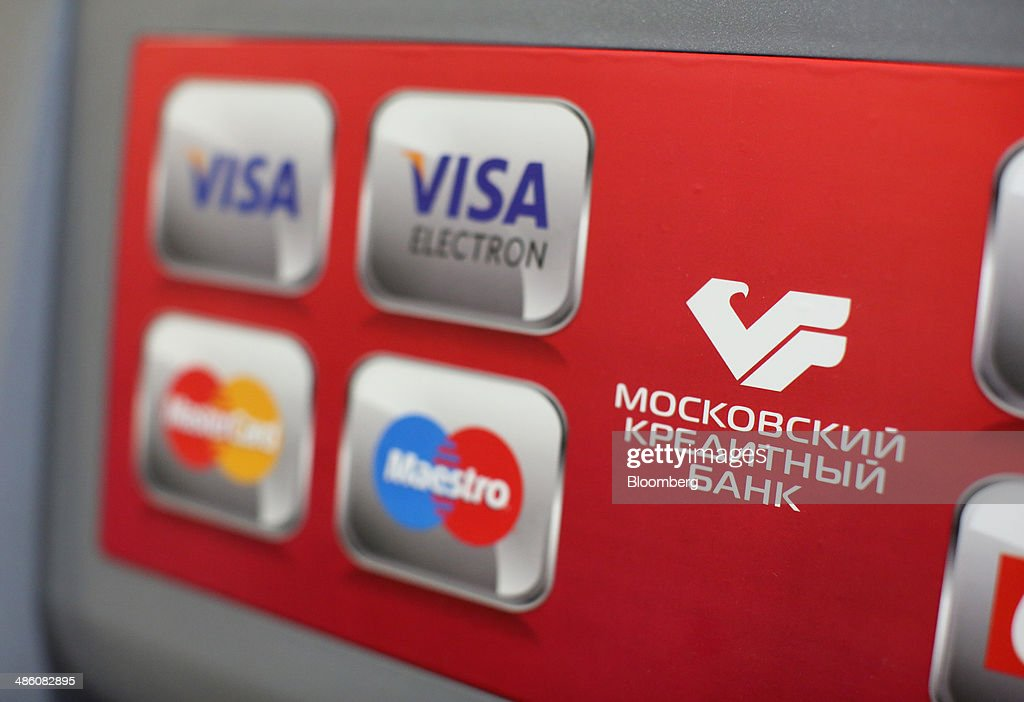 Logos for Visa Inc., Maestro and Mastercard Inc. payment systems sit on an automated teller machine (ATM) used by a customer inside a Credit Bank of Moscow bank branch in Moscow, Russia, on Tuesday, April 22, 2014. Bankers collected $108 million on Russian deals through April 20, compared with $325 million a year earlier, according to data from Freeman & Co., a New York consulting firm. Photographer: Andrey Rudakov/Bloomberg via Getty Images