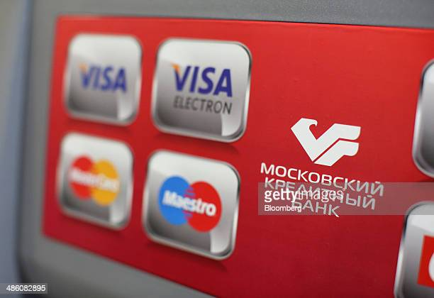 Logos for Visa Inc Maestro and Mastercard Inc payment systems sit on an automated teller machine used by a customer inside a Credit Bank of Moscow...