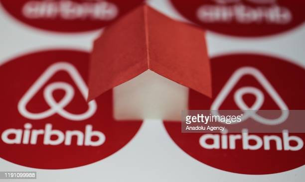 Logos of Airbnb are seen with a house mockup onto it on December 30 2019 in Ankara Turkey