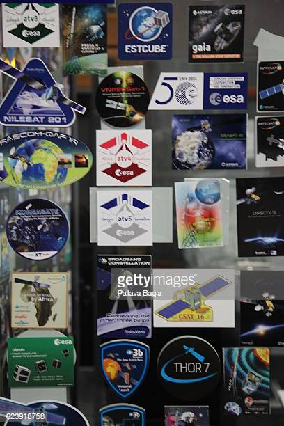 Logo's of different missions that have been launched from Kourou are displayed on a wall in the control room on October 5 2016 in Kourou French...