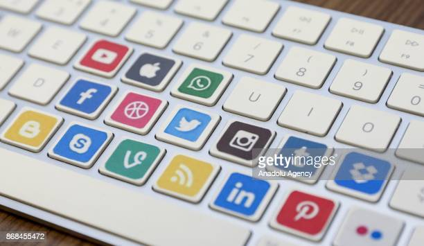 Logos of social media are seen on keyboard keys in Ankara Turkey on October 26 2017
