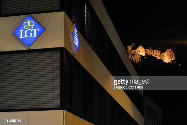 Logos of the LGT Banking Group are seen in front of the Vaduz Castle, on February 18, 2008 in Vaduz. Liechtenstein banking sector could now become a...