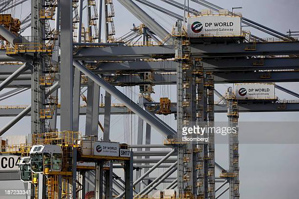 Logos sit on ship to shore cranes as containers are unloaded from the the MOL Caledon container ship operated by Mitsui OSK Lines Ltd at DP World...