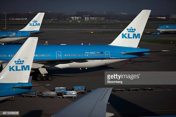 Logos sit on the tail fins of aircraft operated by Air FranceKLM Group at Schiphol Airport operated by the Schiphol Group in Amsterdam Netherlands on...
