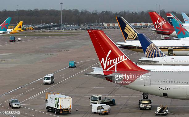 Logos sit on the tailfins of aircraft operated by Virgin Atlantic Singapore Airlines United Continental Holdings Inc First Choice and Thomson Airways...