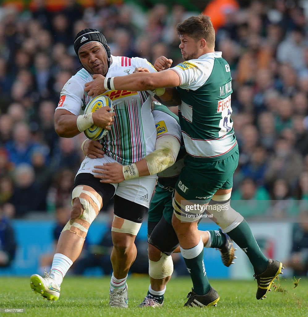 Logovi'i Mulipola (hidden) and Mike Williams of Leicester Tigers tackle Matthew Luamanu of Harlequins during the Aviva Premiership match between Leicester Tigers and Harlequins at Welford Road on October 25, 2015 in Leicester, England.