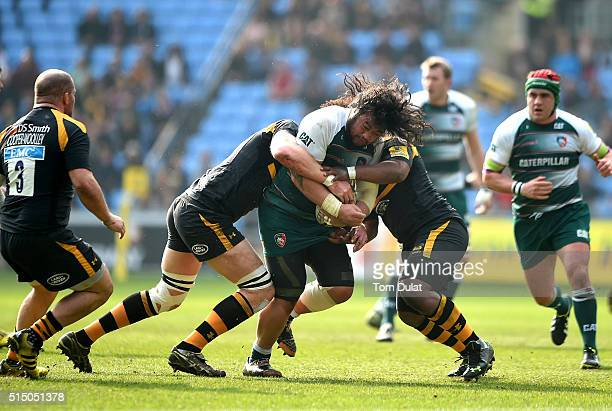 Logovi'i Mulipola of Leicester Tigers is tackled during the Aviva Premiership match between Wasps and Leicester Tigers at The Ricoh Arena on March 12...