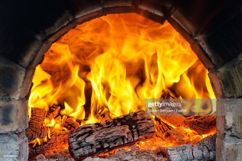 Logs Burning In Fireplace Stock Photo