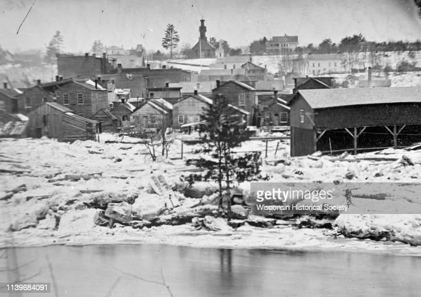 Logs piled on the shore of town possibly due to Ice Gorge of 1876 Black River Falls Wisconsin 1876