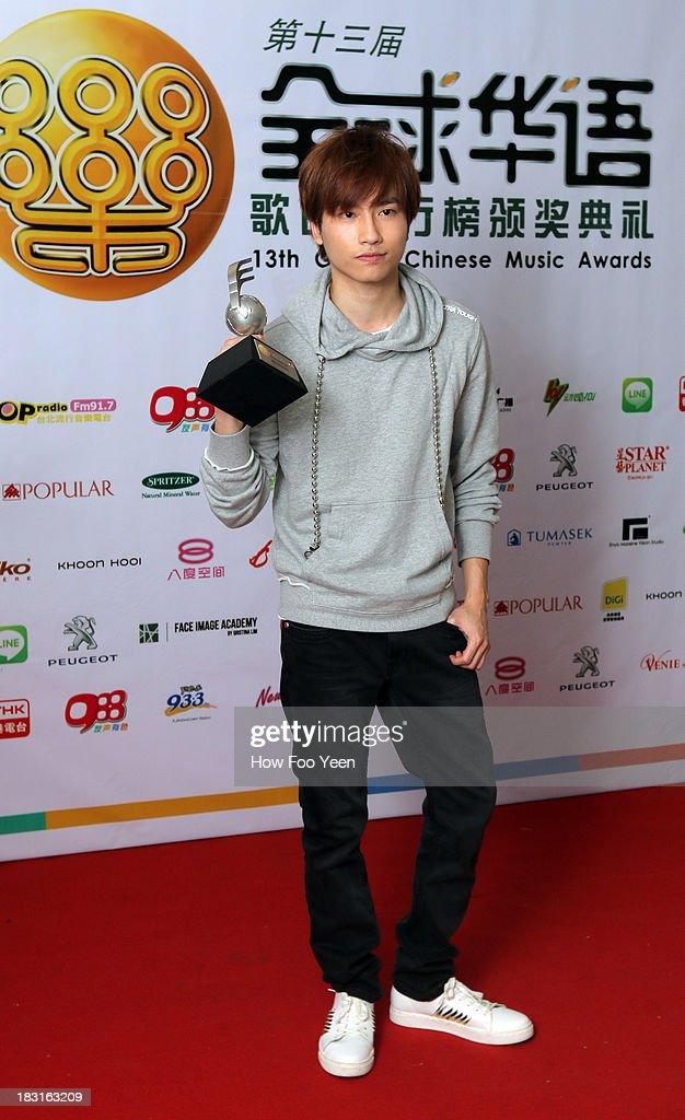 Loh Lek Wai of Hong Kong poses with his Most Popular Composing Artiste Award at back stage during the 13th Global Chinese Music Awards at Putra Stadium on October 5, 2013 in Kuala Lumpur, Malaysia.
