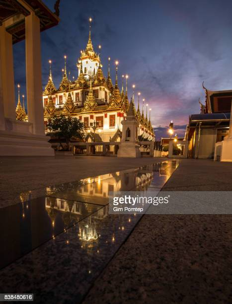 Loha prasat wat ratchanatda is Buddhist religious architecture , bangkok , thailand