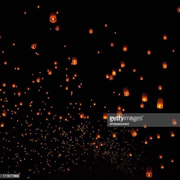 loi krathong mass lantern launch - symbolism stock photos and pictures