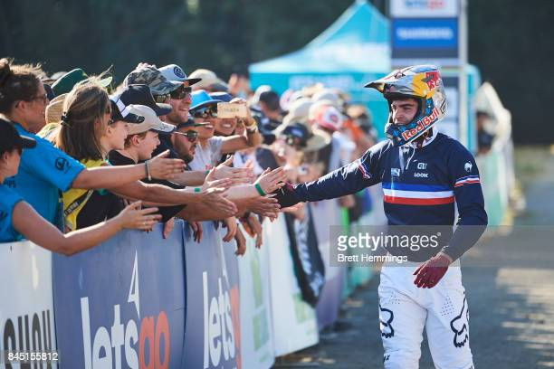 Loic Bruni of France reacts after his winning run in the Elite Mens Downhill Championship during the 2017 Mountain Bike World Championships on...