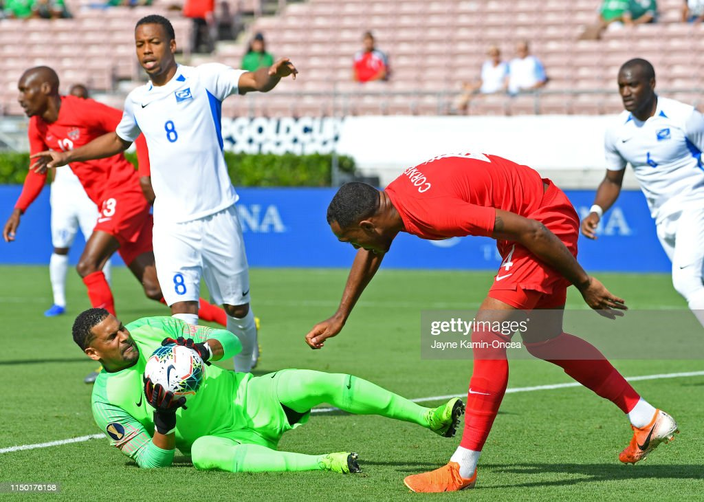 Loic Chauvet of Martinique holds on the ball off a save on a kick by