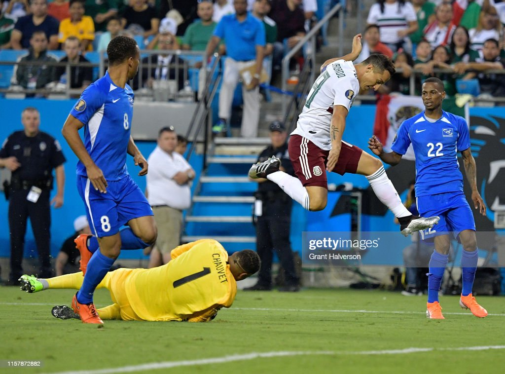 Loic Chauvet of Martinique strips the ball away from Andres Guardado