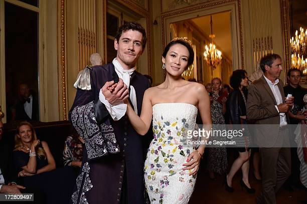 Loic Corbery and Zhang Ziyi dance during the Le Grand Bal De La Comedie Francaise at La Comedie Francaise on July 4 2013 in Paris France