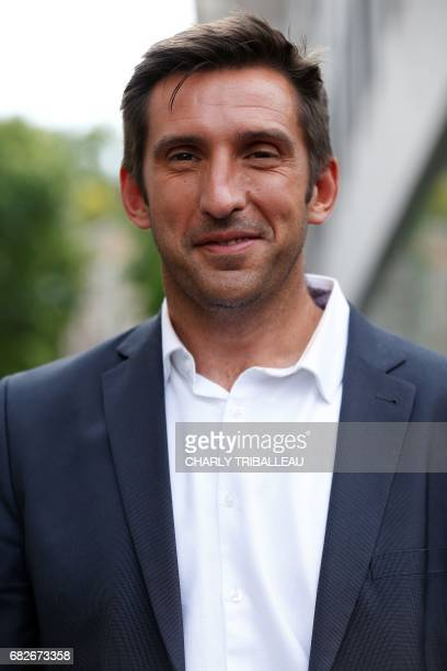Loic Correge candidate in the Pyrenees Atlantique 4 constituency for the party 'La Republique en Marche' poses at the entrance of the Quai Branly...