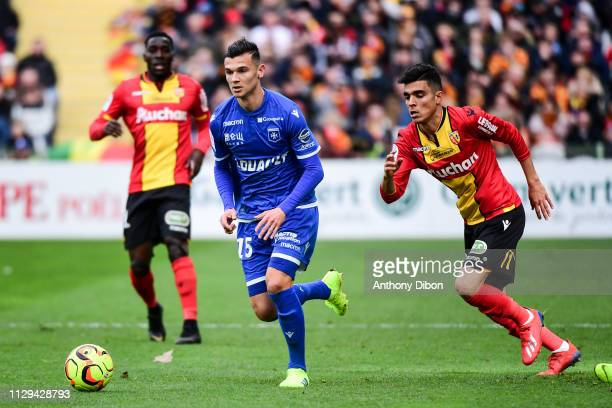 Loic Goujon of Auxerre and Achraf Bencharki of Lens during the Ligue 2 match between RC Lens and AJ Auxerre at Stade BollaertDelelis on March 9 2019...