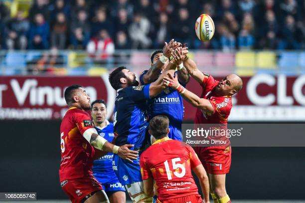 Loic Jacquet and David Smith of Castres and Mathieu Acebes of Perpignan during the Top 14 match between Perpignan and Castres at Stade Aime Giral on...