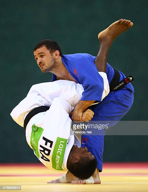 Loic Karval of France and Amiran Papinashvili of Georgia compete in the Men's Team gold match during day sixteen of the Baku 2015 European Games at...